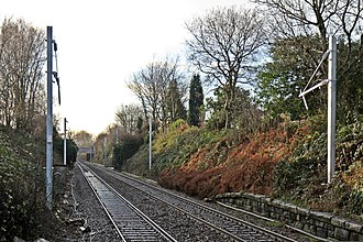 Liverpool–Wigan line - Partially erected catenary at Eccleston Park, in December 2013