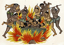 Dark beings throw men with mustaches into a large cauldron with a huge fire underneath it.