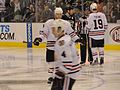 Niklas Hjalmarsson, Brent Seabrook, and Jonathan Toews (5442429604).jpg