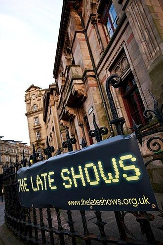 The Late Shows - North of England Institute of Mining and Mechanical Engineers exterior with The Late Shows banner foreground, and the Literary and Philosophical Society of Newcastle upon Tyne beyond.