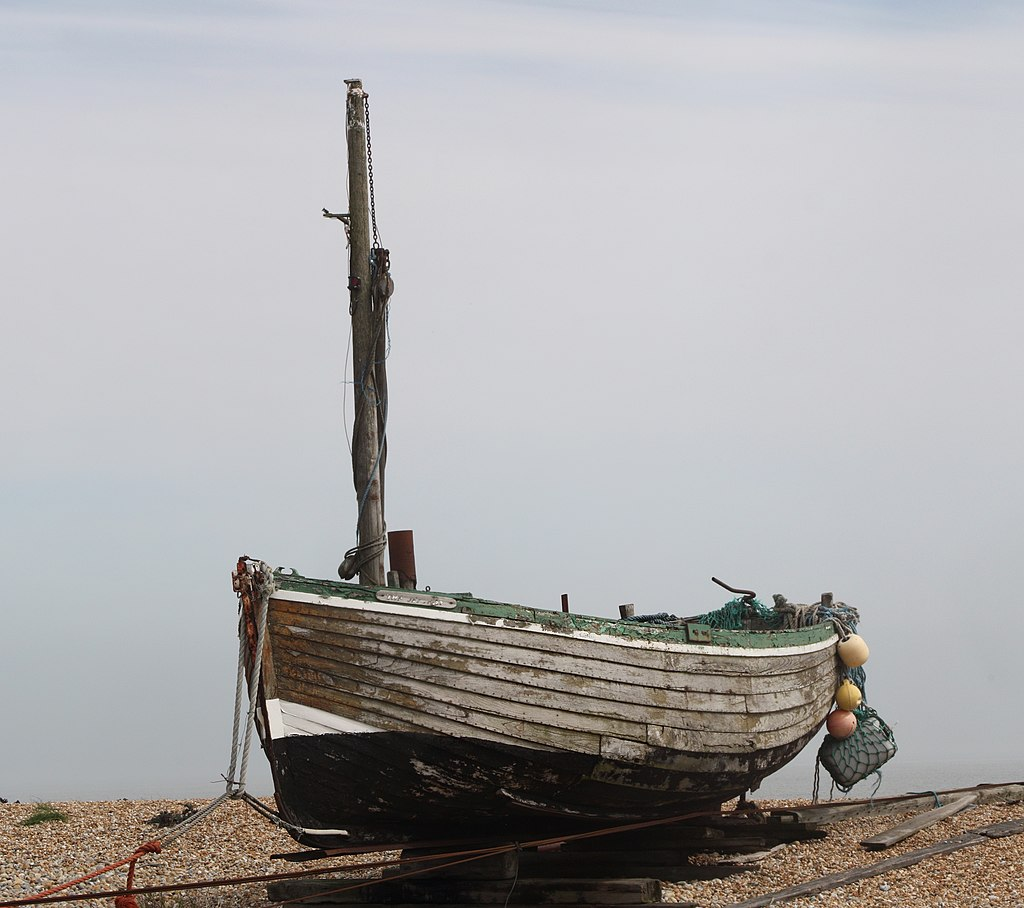 Old Fishing Boats On Beach: An Old Fishing Boat On The Pebble Beach Of Dungeness, Kent