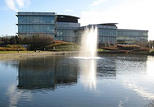 Oxford Science Park - View of Oxford Science Park. Behind the fountain is the Danby Building, an office block completed in 2002, and to the right is the Sherard Building, also offices completed in 2002.