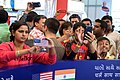 Passersby Try to Get Photo of Secretary Kerry As He Visits U.S. Expo at Vibrant Gujarat Summit in India (16074641490).jpg