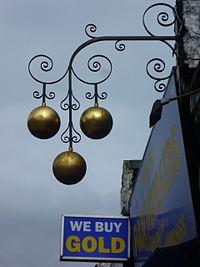 Pawnbroker's sign, Camden High Street, London.JPG