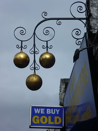 Pawnbroker - A London shop displays the traditional pawnbroker's sign.
