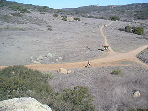 Rancho Peñasquitos, San Diego - A bicyclist enjoys Los Peñasquitos Canyon Preserve near the waterfall.