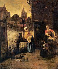 Deux femmes et un enfant dans une cour
