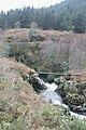 Pipe over waterfall - geograph.org.uk - 1090782.jpg