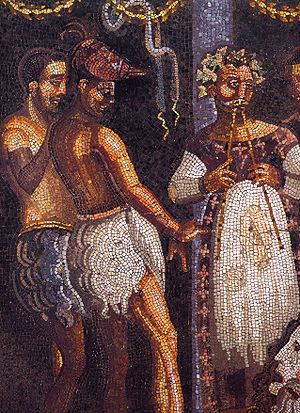 Aulos - Theatrical scene from a Pompeiian mosaic showing a performer with an aulos and phorbeiá.
