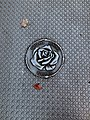 Portland general electric rose symbol with two leaves nearby.jpg