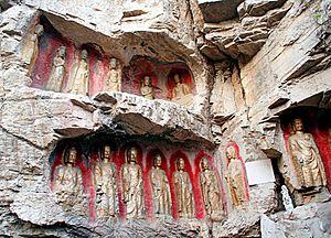 Thousand Buddha Mountain - Buddha statues in a cliff south of the Xingguochan Temple
