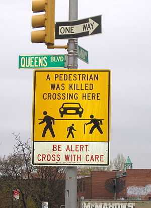 "Queens Boulevard - ""A Pedestrian Was Killed Crossing Here"" sign on Queens Boulevard at Grand Avenue in Elmhurst"