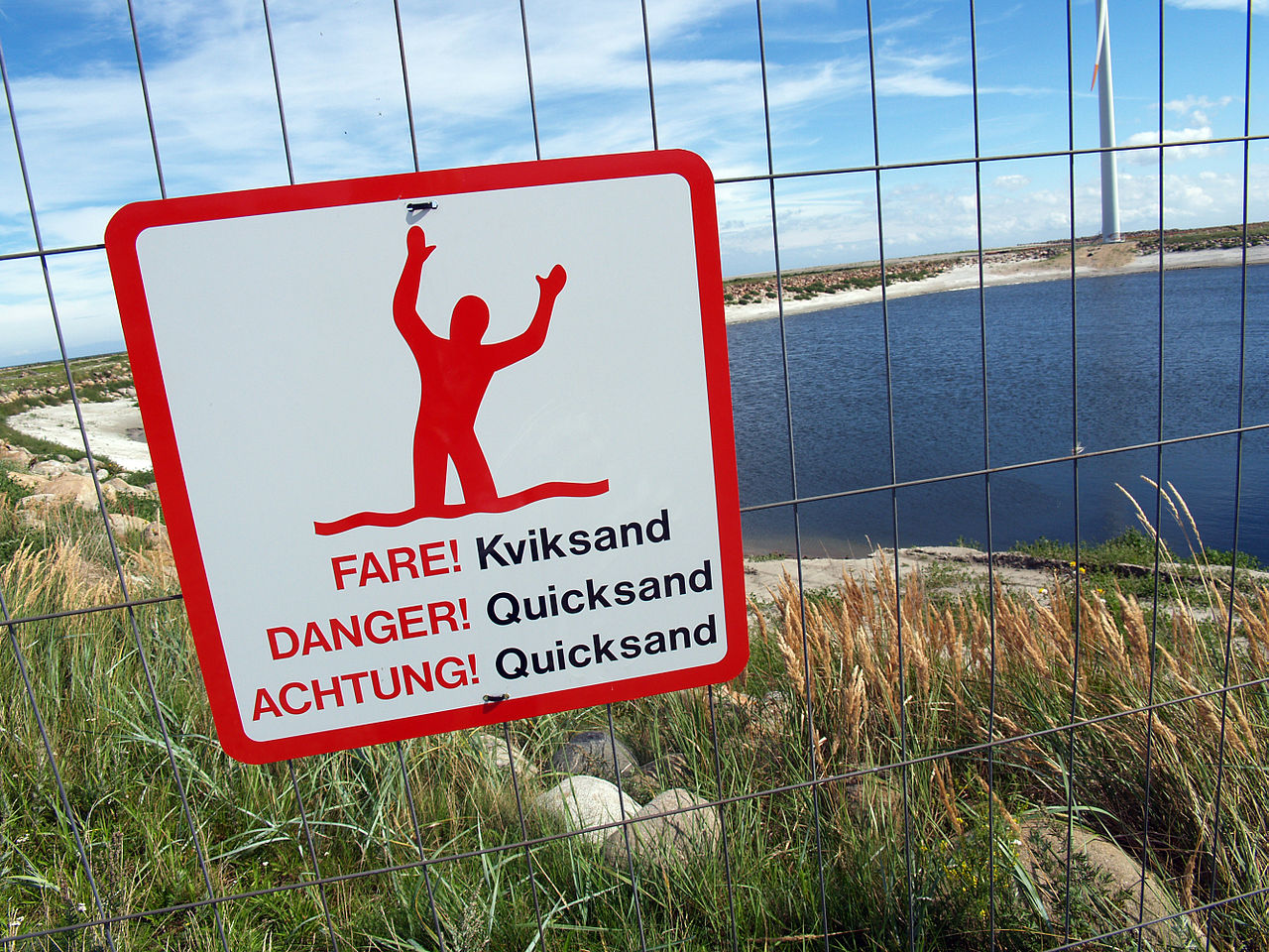 http://upload.wikimedia.org/wikipedia/commons/thumb/5/5c/Quicksand-warning-sign-denmark-2010.jpg/1280px-Quicksand-warning-sign-denmark-2010.jpg