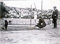 Ray Ewry of the New York Athletic Club competing in the standing broad jump at the 1904 Olympics. Ewry won the event.jpg