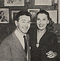 Red Buttons and columnist Jill Warren pose together, 1953.jpg