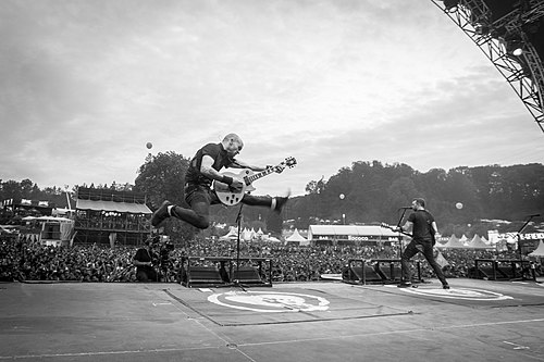 Rise Against performing at Open Air St. Gallen in 2015 Rise Against 2015 black and white.jpg