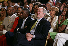Robert L. Johnson with President Bush.jpg