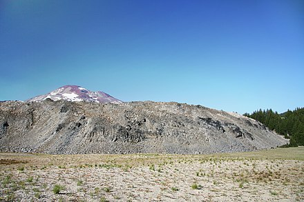 Rock Mesa is an example of a rhyolite dome near the Three Sisters. South Sister rises in the background. Rock Mesa obsidian flow in Oregon in 2011 (12).JPG