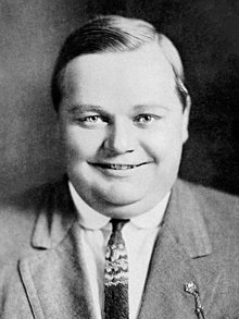 Arbuckle smiling in a suit
