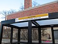 Route 64 sign on bus shelter, Chestnut Hill Avenue at Wiltshire Road, December 2016.JPG