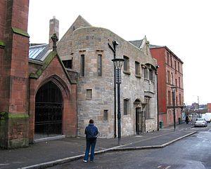 Ruchill Church Hall - To the south of the halls a tenement stands at the junction to Maryhill Road
