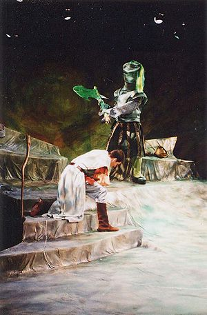 The Green Knight about to chop Sir Gawian's he...