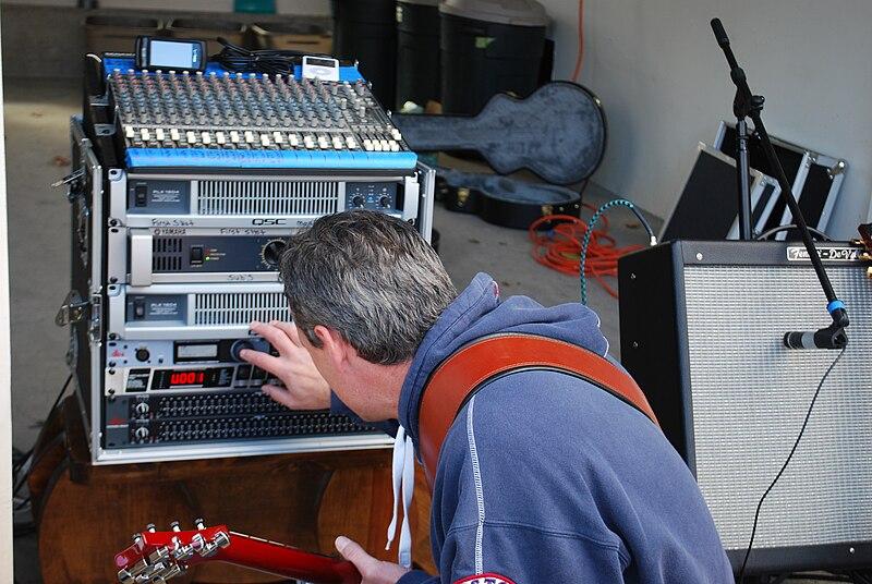 File:SR rack, First Shot Band - Jim tweaking knobs.jpg