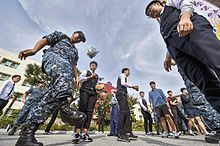 Sailors play Jegichagi with Korean students during a community relations event (30361247131).jpg