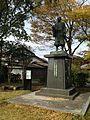 Sculpture of Tanaka Yoshimasa near Yaemombashi Bridge in Yanagawa, Fukuoka.jpg