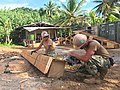 Seabees cut form work for a bond beam for Walung Health Clinic project in Micronesia. (34553232822).jpg