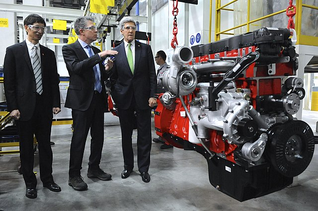 Cummins Vice President Steve Chapman shows U.S. Secretary of State John Kerry an assembled clean-diesel engine while touring the Cummins-Foton Joint Venture Plant in Beijing, China, on Feb. 15, 2014