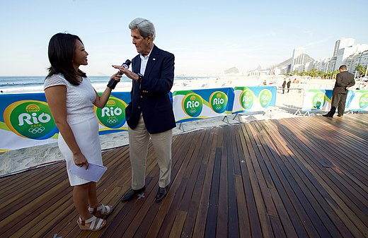 Secretary Kerry speaks with a Boston reporter along the Copacabana Beach in Rio (28772468146).jpg