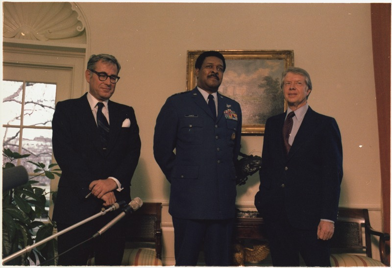 "Secretary of Defense Harold Brown and General Daniel ""Chappie"" James visit with Jimmy Carter. - NARA - 177740"
