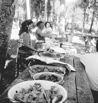 Seminoles having a Thanksgiving Meal in the mid-1950s Seminole Indian Thanksgiving Meal (5184648544).jpg