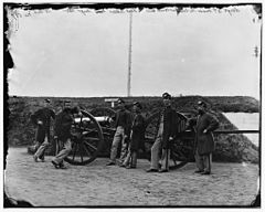 Sergeants of 3d Massachusetts Heavy Artillery, with gun and caisson at Fort Totten.jpg