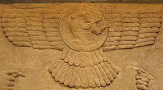 Shamash - Male figure in an Assyrian winged sun emblem (Northwest Palace of Nimrud, 9th century BCE; British Museum room B, panel 23). This iconography later gave rise to the Faravahar symbol of Zoroastrianism.