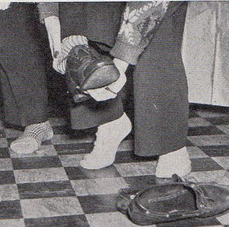 Sock hop - Students removing their shoes for a sock hop.