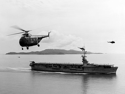 A US Navy Sikorsky HO4S flying near USS Sicily Sikorsky HRS-1 of HMR-161 in flight over USS Sicily (CVE-118) off Inchon on 1 September 1952 (80-G-477573).jpg