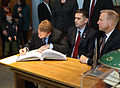 Soyuz TMA-19M crew signs a ceremonial book at the Gagarin Museum.jpg