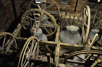 "Change ringing - The bells of St Bees Priory shown in the ""down"" position, where they are normally left between ringing sessions. This is in the ""bell chamber""."