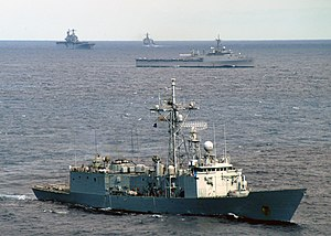 Starboard bow view of SPS Navarra (F85) during Standing Naval Force Atlantic exercise with USS Trenton (LPD-14), USS Saipan (LHA-2), and USS Simpson (FFG-56) in background 040925-N-8327M-001.jpg