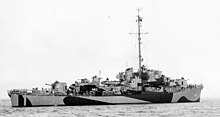 A right facing ship in quarter view with dazzle camouflage