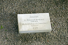 "Stone set on the ground which is inscribed with ""Justus, first Bishop of Rochester 604–624, fourth Archbishop of Canterbury 624–627, d. 627"""