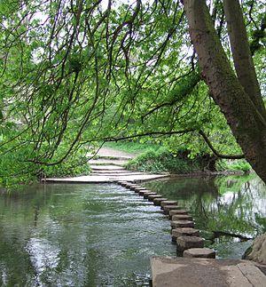 The North Downs Way crosses the River Mole via...