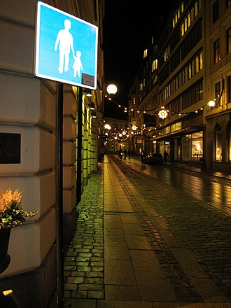 Pedestrian zone - Sign for pedestrian street in Central Stockholm showing a father and daughter