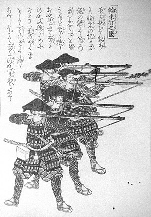 Tanegashima (gun) - Japanese foot soldiers (ashigaru) firing hinawaju (matchlocks). Night-shooting practice, using ropes to maintain proper firing elevation.