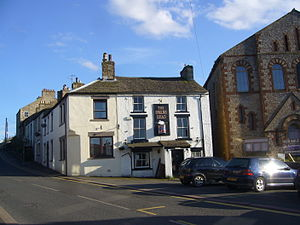 Alston, Cumbria - Swan's Head public house when empty in 2014; it has since been converted for residential use. At right is the former Methodist Church, now derelict.