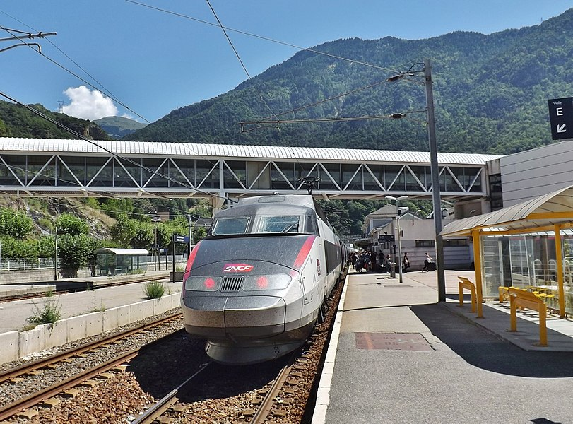 Sight of the French TGV n° 6429 on summer service from Paris to Bourg-Saint-Maurice in the Tarentaise valley, here stopping at Moûtiers station, a few kilometers from its terminus, in Savoie, France.
