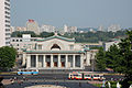 Taedongmun Cinema in Pyongyang with trolley buses passing.jpg