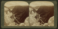 Ten Miles of yawning chasm - down the cañon from Inspiration Point, Yellowstone Park, U.S.A, by Underwood & Underwood 3.png